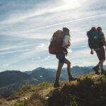 couple-hiking-mountain-climbing-1296x728-header