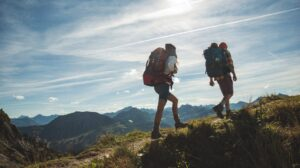 couple-hiking-mountain-climbing-1296x728-header